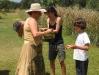 Lorella che distribuisce l'acqua di San Giovanni la mattina del 24 giugno 2012